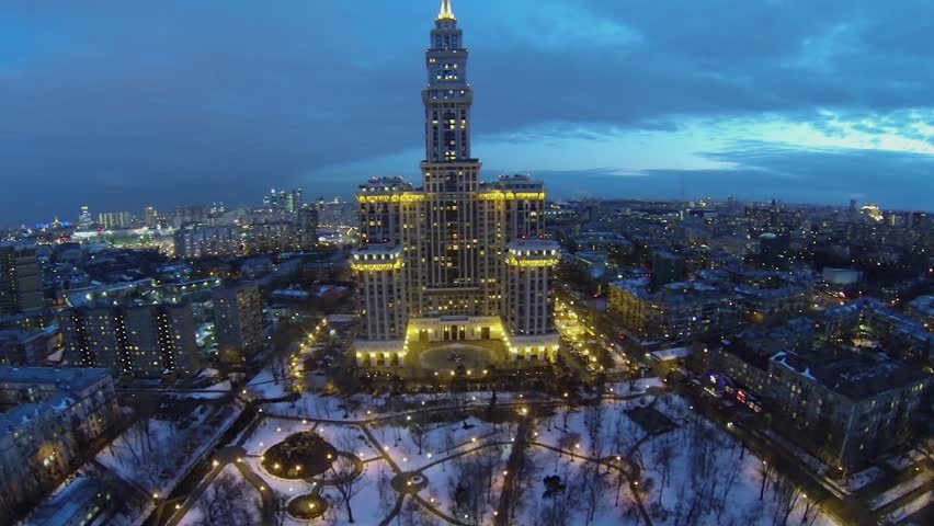MOSCOW, RUSSIA - APR 02, 2014: Tall Residential Complex Triumph Palace  Against Cityscape At Evening. Aerial View. Complex Was Commissioned In 2006  Stock ...