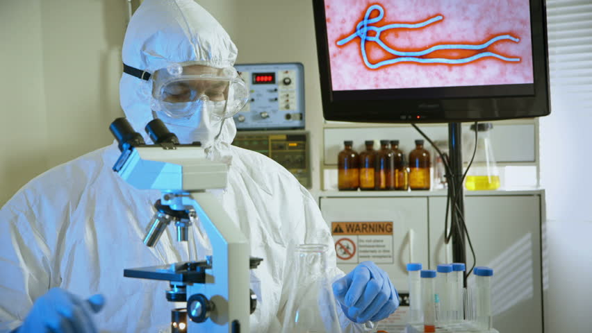 virologist looking at a sample in the microscope - HD stock video clip
