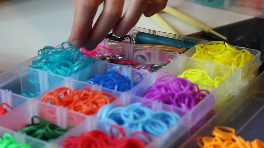 Child play with colorful loom bands -  Tracking shot - HD stock footage clip