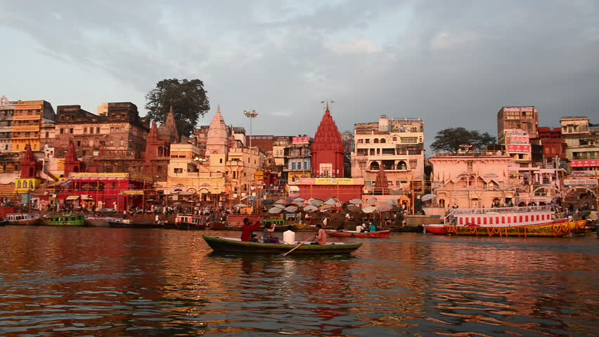 Holy city of Varanasi seen from Ganges river. Pan left.