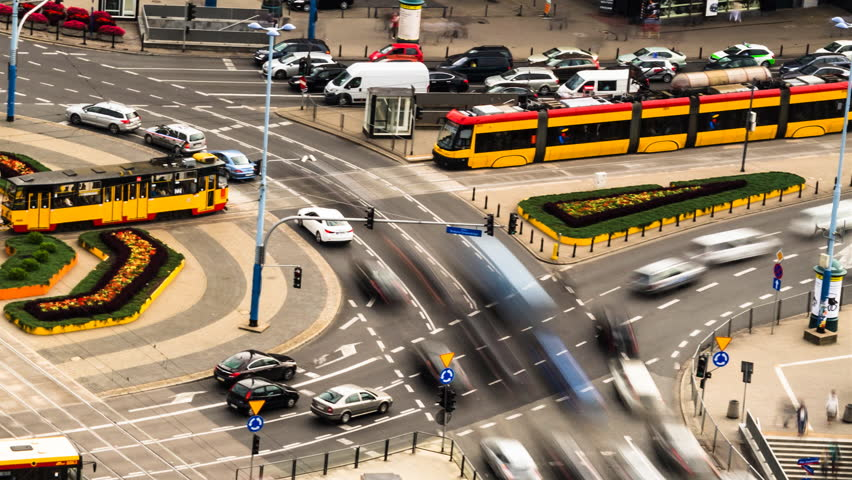 Collection of clips of city traffic at rush hour with many cars, trams, buses moving fast in time lapse, taken in Warsaw, Poland