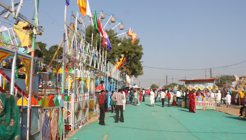 Pushkar, India, November 27, 2012. Indian People at Puskar Fair. The Pushcar Camel Fair, held each november, Pushkar Camel Fair is one of India's most highly-rated travel experiences - HD stock video clip