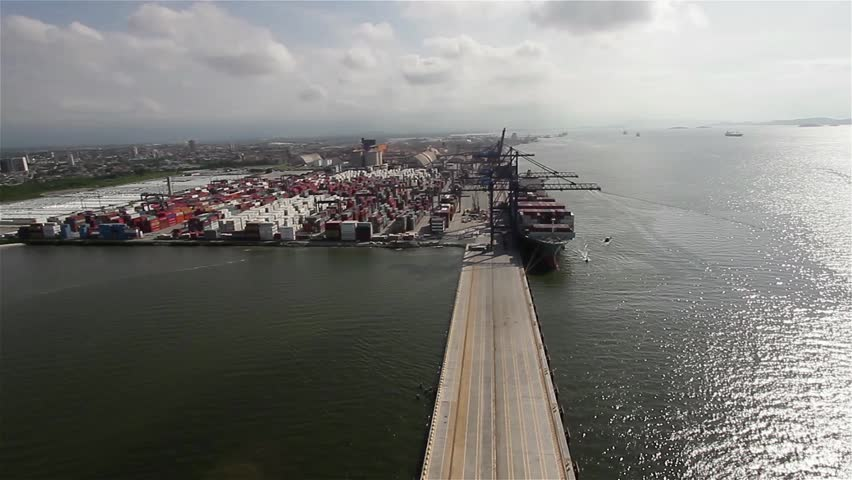 Paranagua, Brazil - April 7 - Aerial view of the port of paranagua, ships unloading soybean unloading, transportation of wealth parana