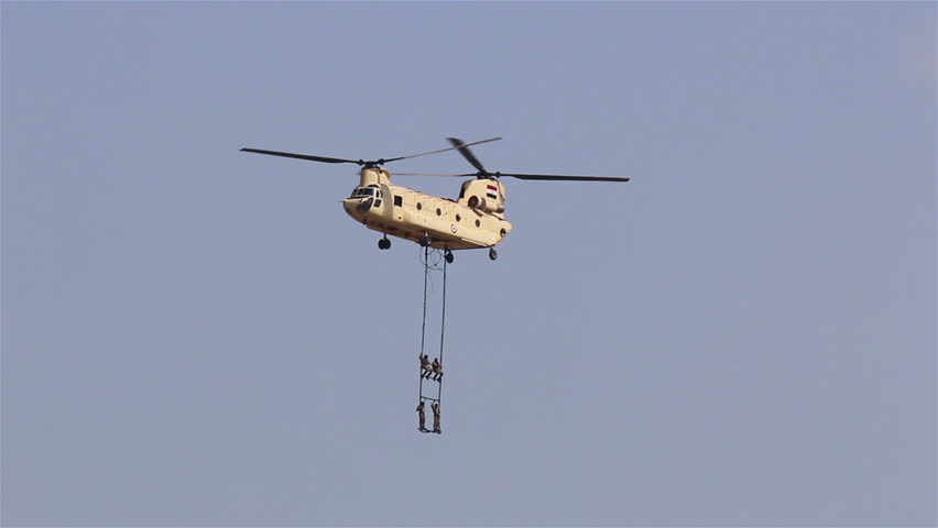 Cairo. Egypt. 6 October 2014. Soldiers waving flags in a helicopter CH-47 Chinook at the airshow. Cairo. Egypt.
