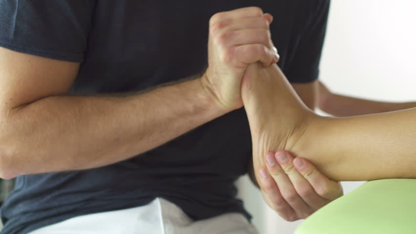 close up physiotherapy of female foot