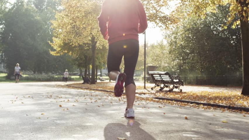 Runner woman running in park excercising outdoors