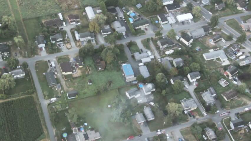 News aircraft view of suburban neighborhood home on fire