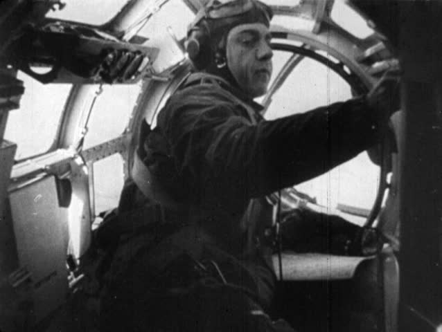 EUROPE - CIRCA 1939-1944: World War II. Nose turret machine gunman. aerial POV over explosions, POV from cockpit of other British war planes in flight, aerial POV of bomb exploding in city