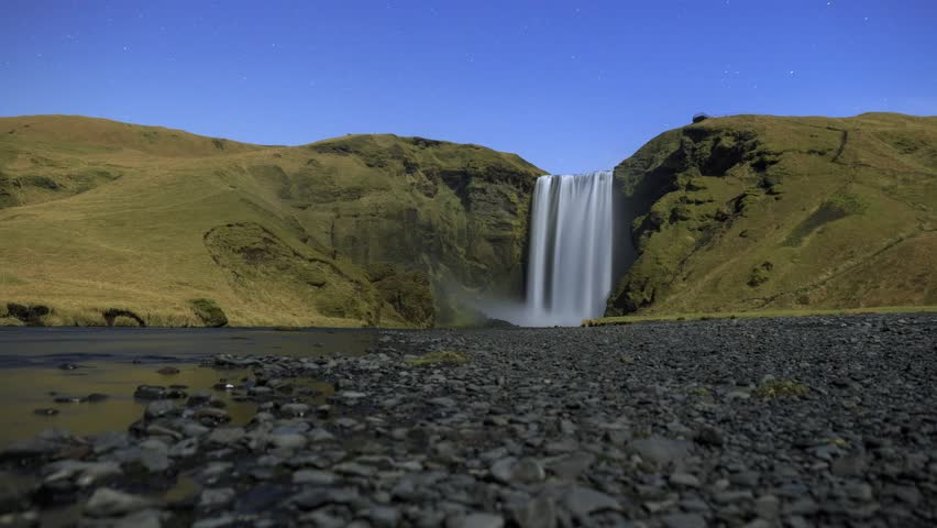 Skógafoss / Skogafoss, a powerful waterfall in southern Iceland.  Timelapse footage filmed by moonlight.
