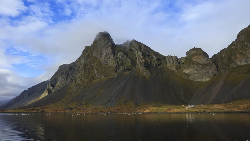 Hvalnes Nature Reserve in south east Iceland; timelapse footage at 24mm with clouds, lake, and swans.