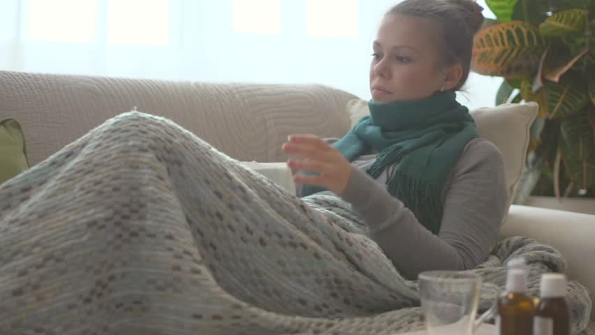 Sick Woman Lying On Her Sofa At Home Flu Woman Caught