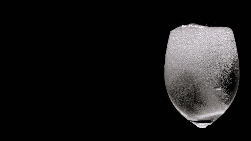 Slow Motion: Pill being dropped in glass of water, dissolves with lots of bubbles. (165 fps / HD-Highspeed-Camera)