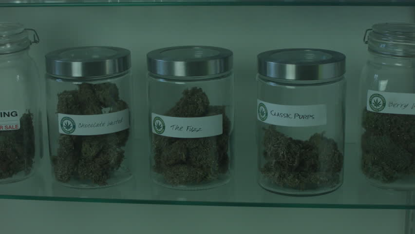 "MEDICAL MARIJUANA CONTAINER IS REMOVED FROM A DISPLAY CASE INSIDE A MEDICAL MARIJUANA DISPENSARY. VERSION 2. ALL LABEL ARTWORK WAS CREATED & CLEARED BY ""PROP HEAVEN"" IN BURBANK, CALIFORNIA."