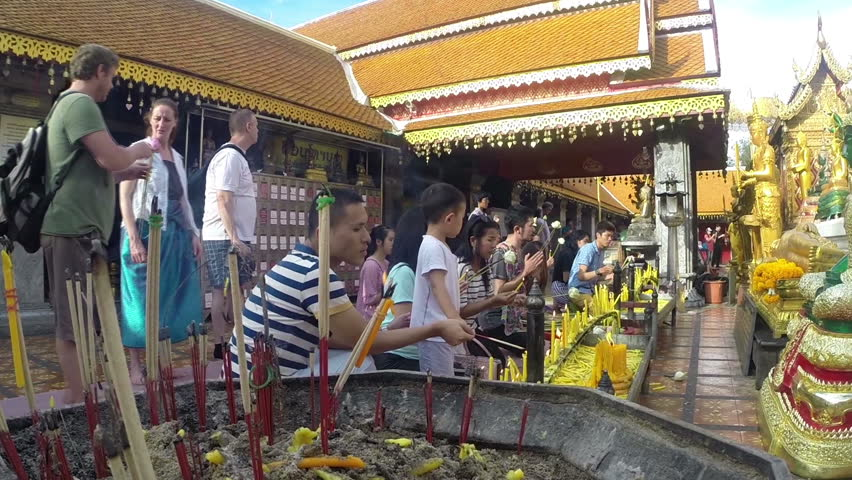 CHIANG MAI, THAILAND - CIRCA OCTOBER 2014: Locals and tourists come to pray at the Doi Suthep Temple. The temple founded in 1385 is a major tourist attraction in Chiang Mai.