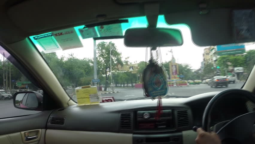 BANGKOK - OCTOBER 20, 2014: Taxicab interior with the city view on background in Busy Downtown of Bangkok,THAILAND..