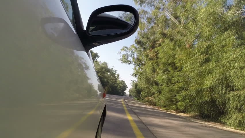 Car driving on the country road. Side view