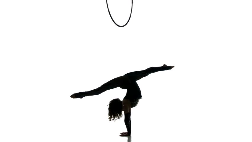 Gymnast girl figure isolated on white background. Black silhouette of gymnastic woman