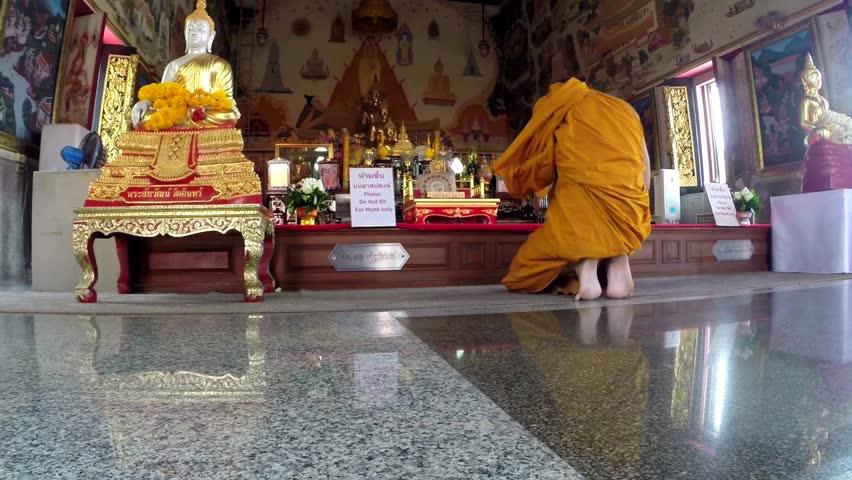 CHIANG MAI, THAILAND - OCT 9:Buddhist monk pray in temple with hands clasped , Chiang Mai, Thailand,October 9, 2014.