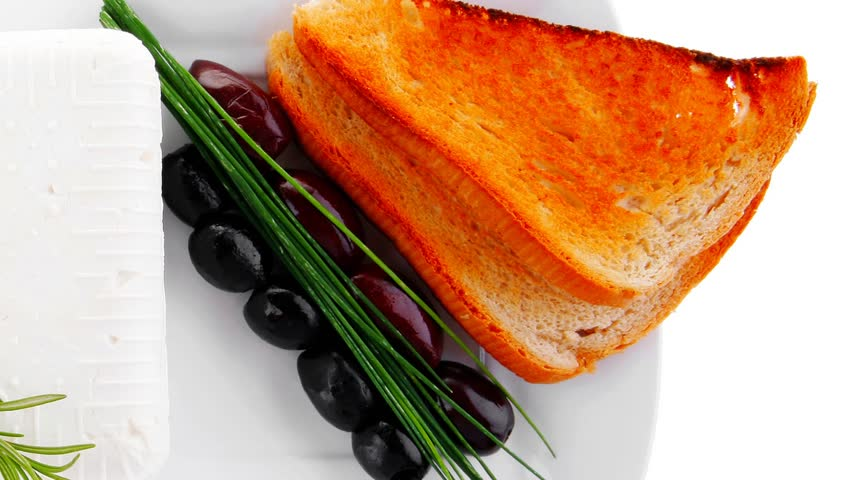 soft feta cube and bread toast on plate 1920x1080 intro motion slow hidef hd
