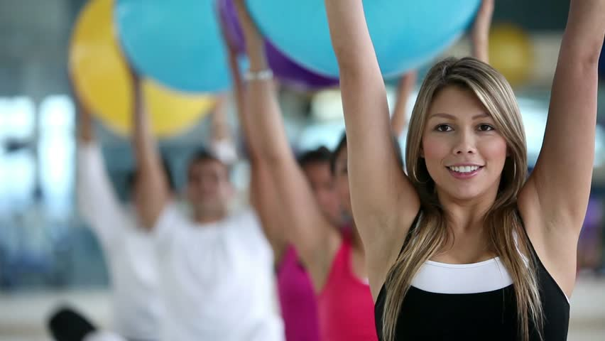 Group of people exercising at the gym with pilates ball - HD stock video clip
