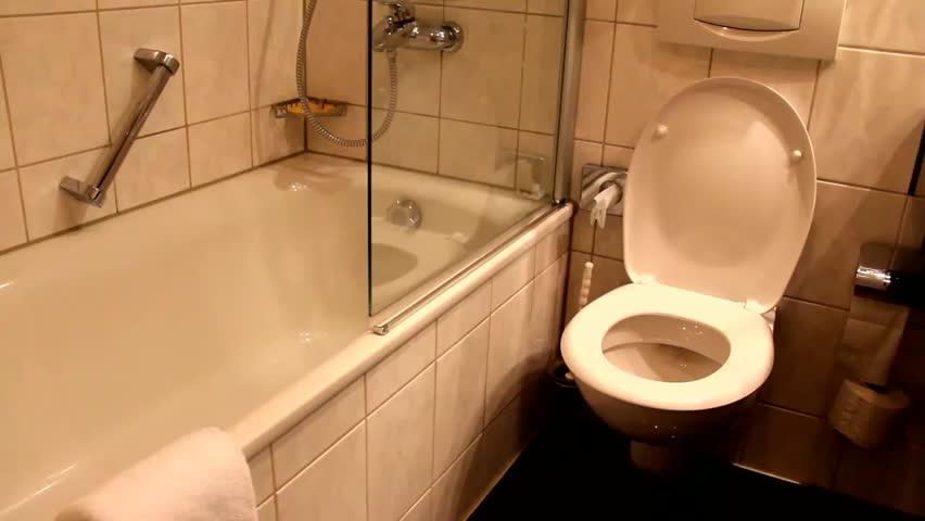 Flush water  in toilet bowl