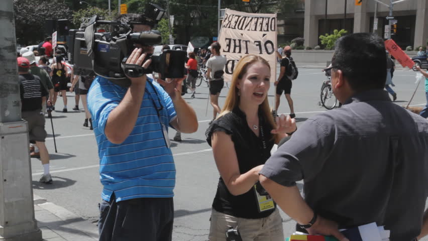 TORONTO, ONTARIO - JUNE 24th: Woman interviews native leader on June 24th, 2010, Toronto, Ontario, Canada. Native groups staged a peaceful  protest on the eve of the G20.