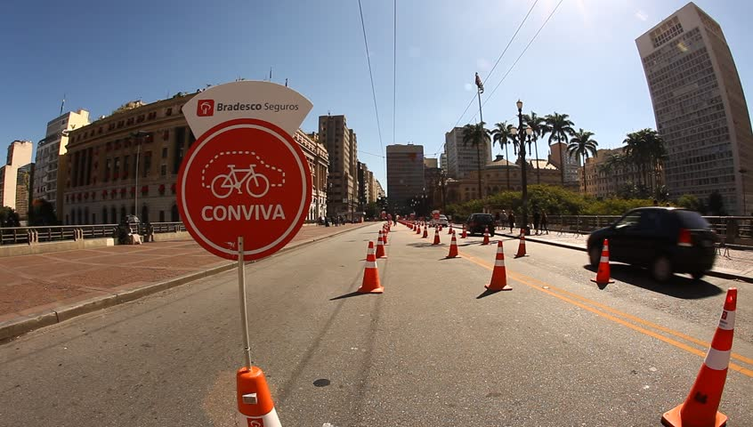 SAO PAULO, BRAZIL-CIRCA 2013: New public bicycle rental project in streets of Sao Paulo Brazil. Most active on Sundays with special lane for bikes - HD stock video clip