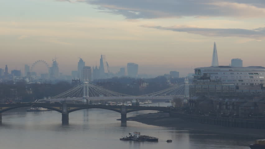 London skyline, early morning, late January, just before sunrise, view east down the River Thames from Chelsea Harbour.