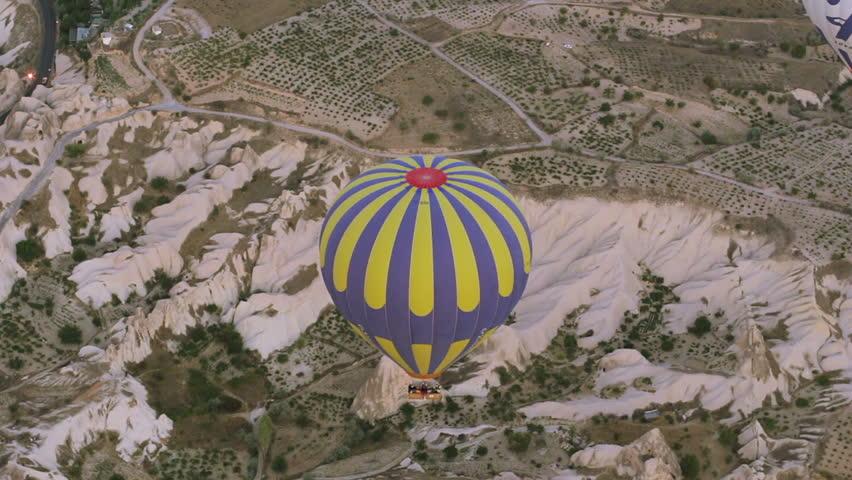 "CAPPADOCIA, TURKEY - August 30 2014:""the Hot air balloon flying over rock landscape at Cappadocia Turke""  On August 30, 2014 in Cappadocia, Turkey."