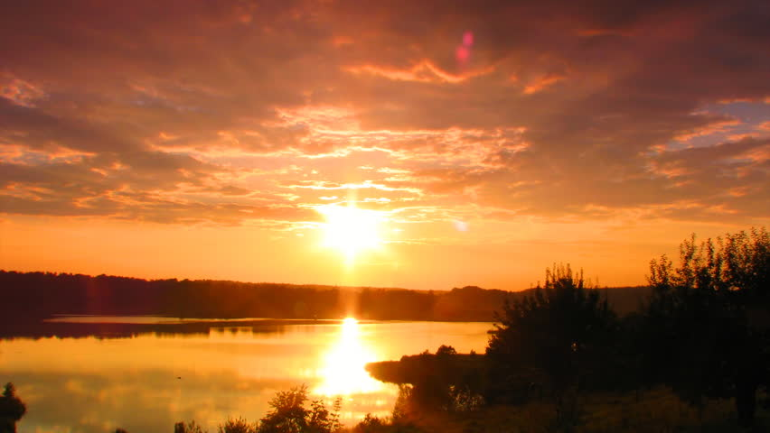 sunset on the lake, time-lapse - HD stock video clip