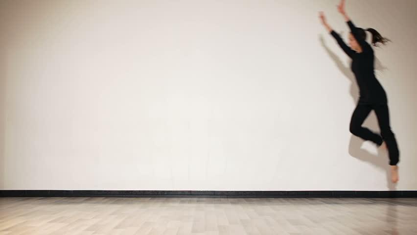 Girl doing gymnastic flip. Acrobatic flip.