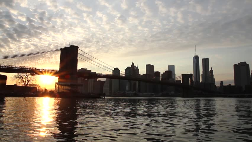 Beautiful view of Manhattan skyline and Brooklyn bridge at sunset. Time lapse.