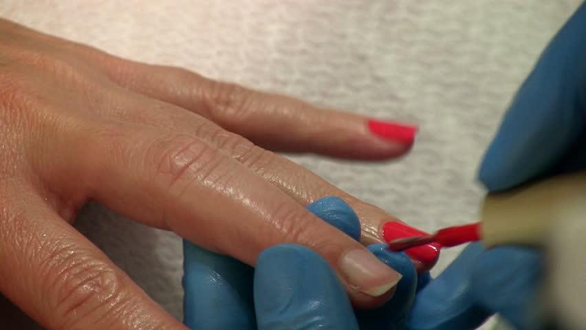 Red nail polish on female nails.  Nail Polish