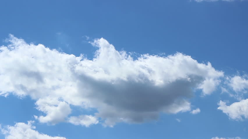 """On a clear blue sky white clouds pass quickly as if being chased by an unknown """"hunter""""."""