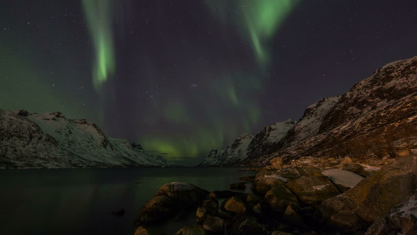 Panning timelapse of aurora borealis in norway near tromso stock