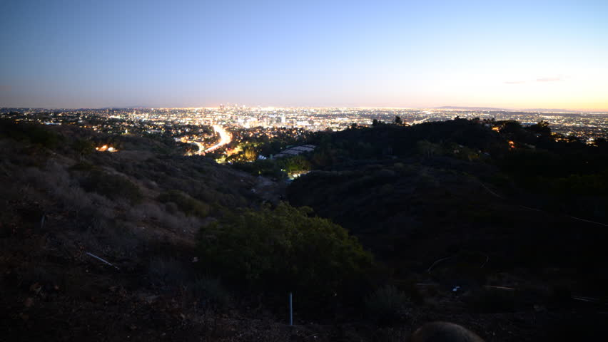 Time lapse footage with tilt up motion of Los Angeles cityscape at twilight wide shot in Los Angeles, California