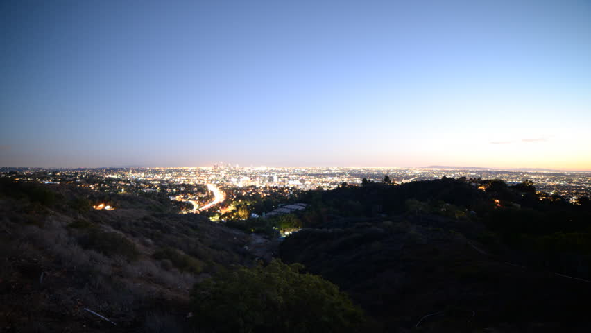 Time lapse footage with zoom in motion of Los Angeles cityscape at twilight wide shot in Los Angeles, California