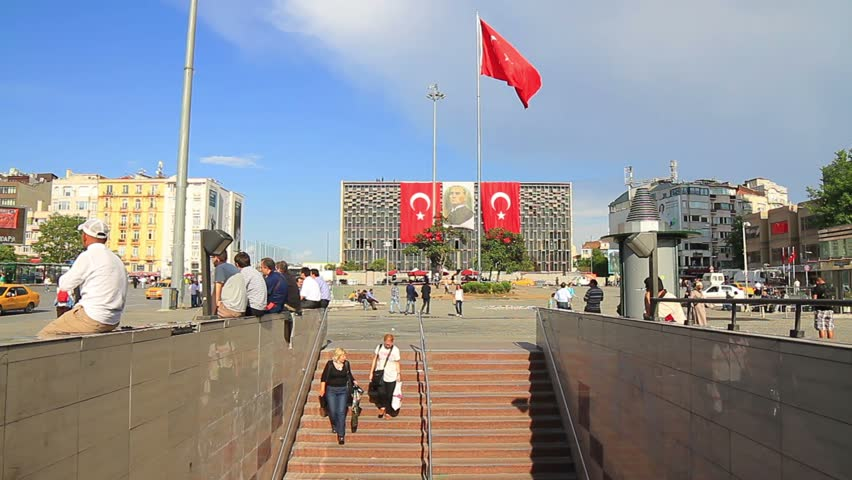 ISTANBUL - JUN 17, 2013: Taksim Square AKM Building over the underground station entrance