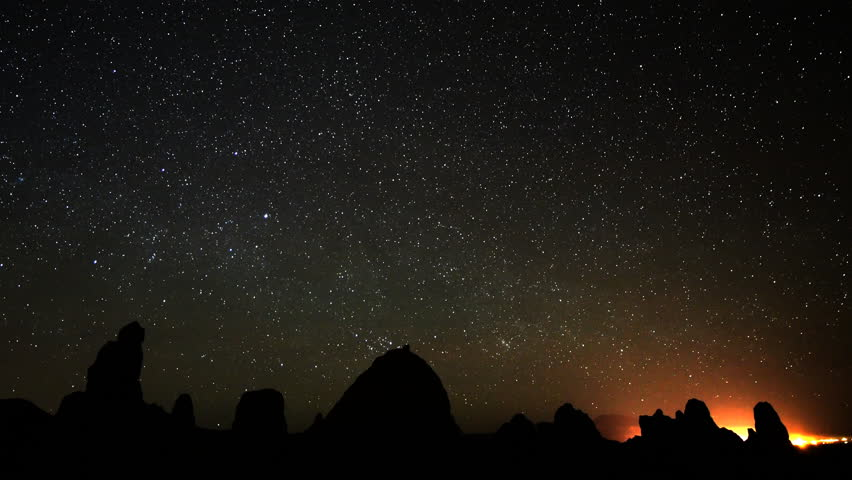 4K Astrophotography time lapse footage of star trails over tufa formations at dawn in Trona Pinnacles, California, long shot