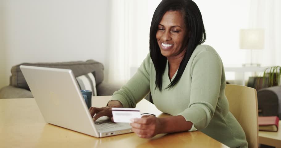 Mature Black Woman Shopping Online Laptop Computer Stock