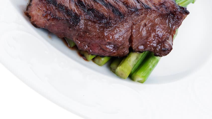 meat table : grilled beef fillet with asparagus served on plate 1080p 1920x1080 intro motion slow hidef hd