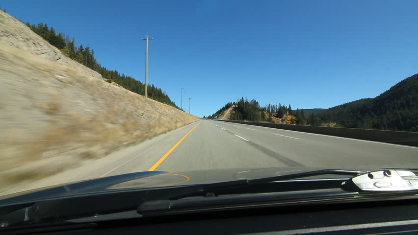 Driving north on the Coquihalla Hwy. South of Merritt, BC, Canada.  Driving north on the Coquihalla Hwy approx 36 km south of Merritt, BC, Canada.   - HD stock footage clip