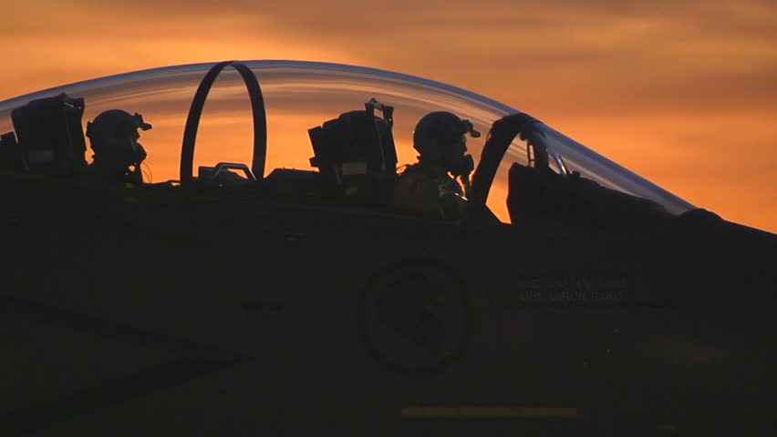 CIRCA 2010s - F-15 fighter jets taxis on a runway at sunset.