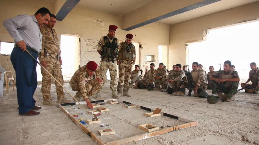 CIRCA 2010s - U.S. soldiers train the Iraqi Army in commando tactics.