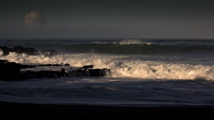 HAWAII - CIRCA 2015 - Waves roll into a beach following a big storm. - HD stock footage clip