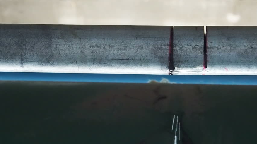 Slow motion Close up water leak drop from steel pipe.  - HD stock footage clip