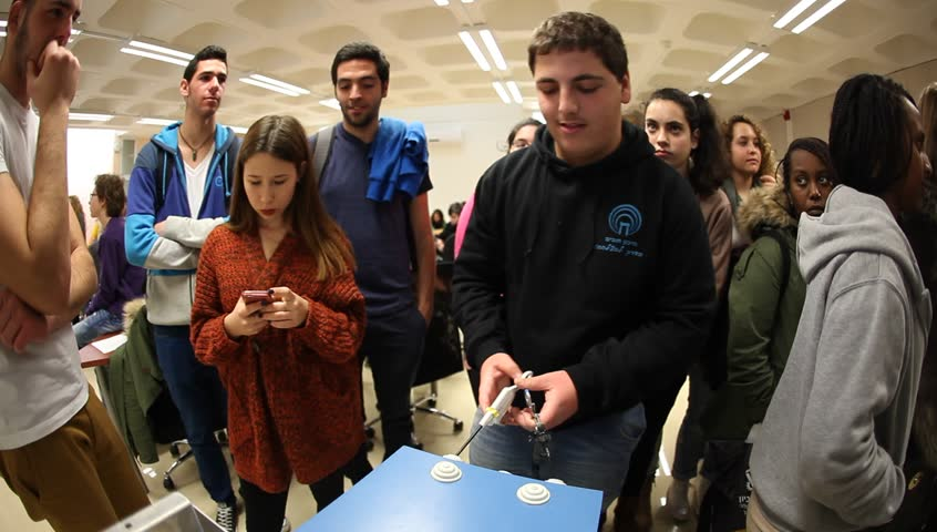 HAIFA, ISRAEL - MARCH 06, 2015: High school pupils experience endoscopic surgery on simulator at Technion. Students visit the Technion University to witness scientific experiments.