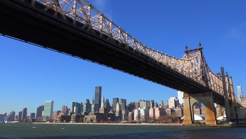 NEW YORK CITY - CIRCA 2015 - Low angle view of the Queensboro Bridge with the New York skyline background. | Shutterstock HD Video #9227546