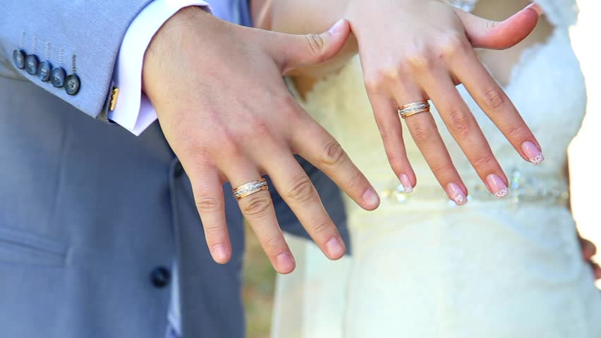 Bride And Groom Showing Gold Wedding Rings On Their ...