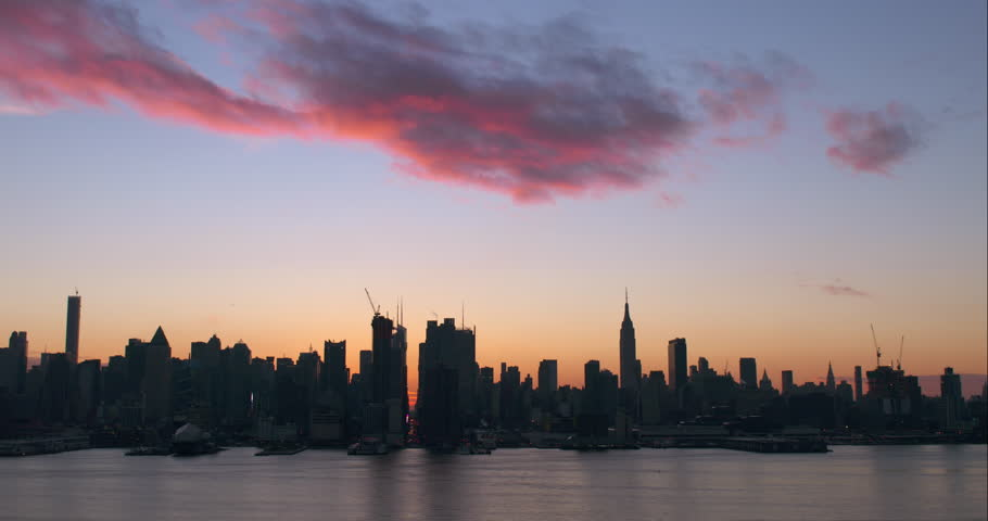 Orange and pink clouds above the Midtown Manhattan skyline | Shutterstock HD Video #9324053